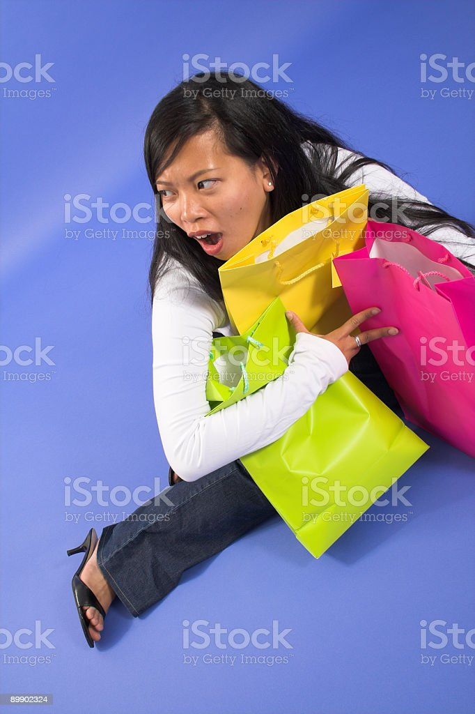 woman holding shopping bags royalty-free stock photo