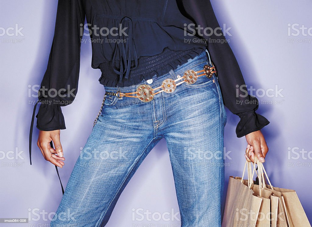 Woman holding shopping bags royalty free stockfoto