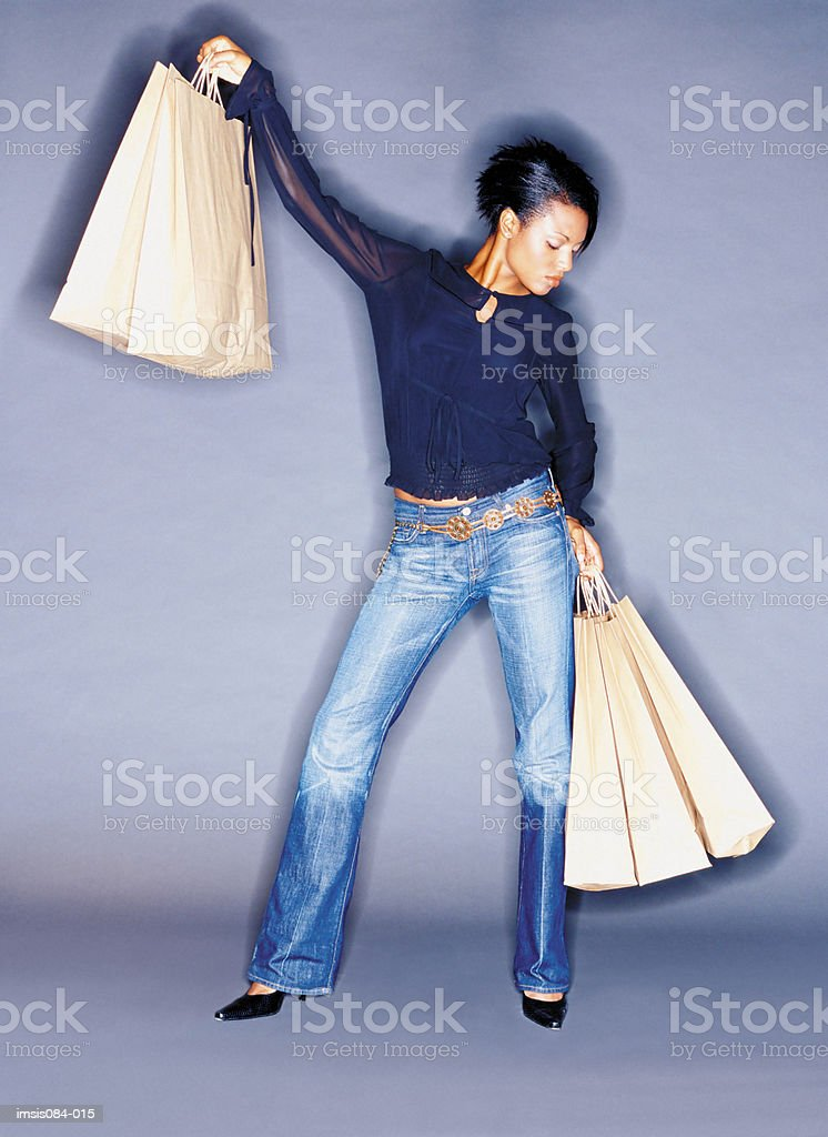 Woman holding shopping bags 免版稅 stock photo