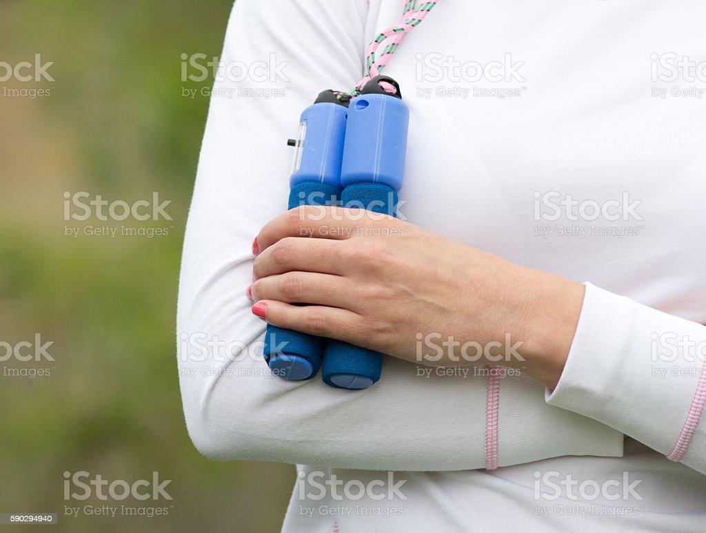 Woman holding skipping rope royaltyfri bildbanksbilder