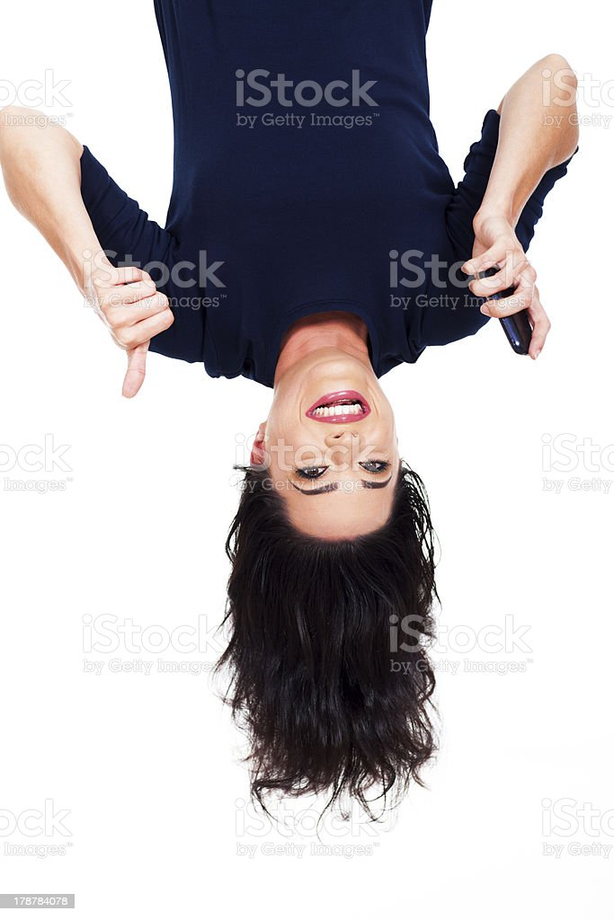 woman holding smart phone and giving thumb up upside down stock photo