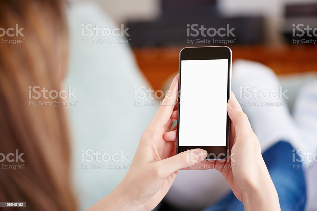 Woman holding smart phone with white screen stock photo
