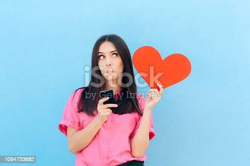 898149690 istock photo Woman Holding Smartphone Finding Internet Love Online 1094733682