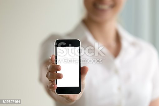 863476202istockphoto Woman holding smartphone, mockup screen for mobile ads, copy space 827627464