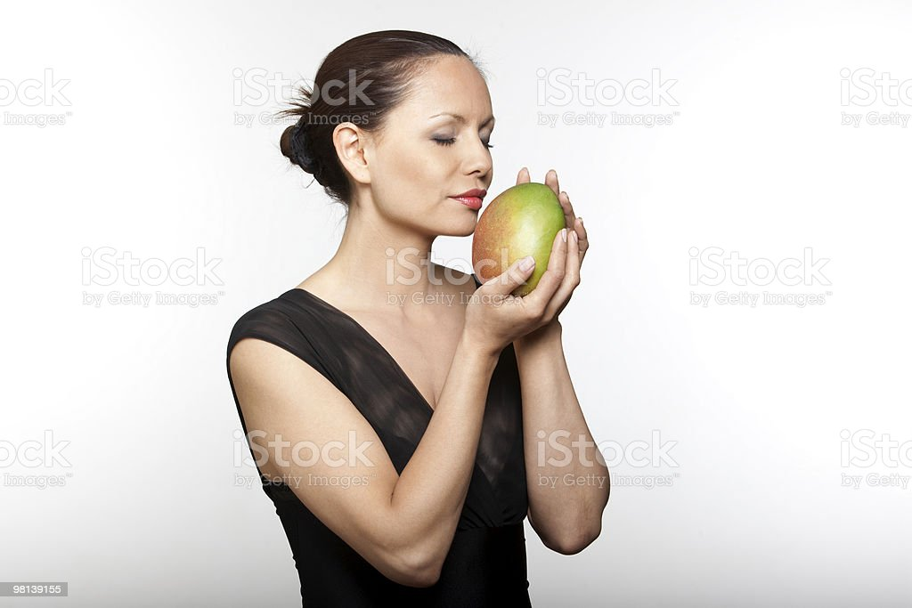 woman holding smelling mango royalty-free stock photo
