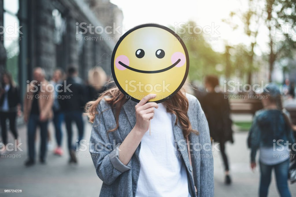 Woman holding smiling sign on her face outside - Royalty-free Adolescence Stock Photo