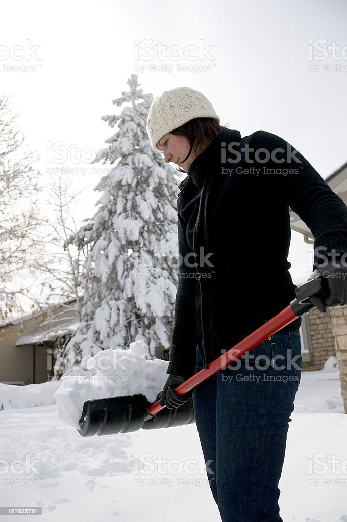 Woman Holding Snow Shovel royalty-free stock photo