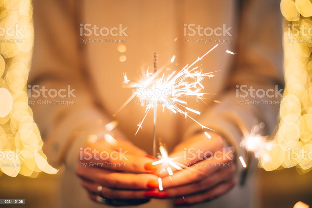 Woman holding sparkler stock photo