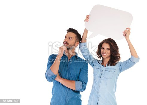 854381780istockphoto woman holding speech bubble near man to show his thoughts 854381602