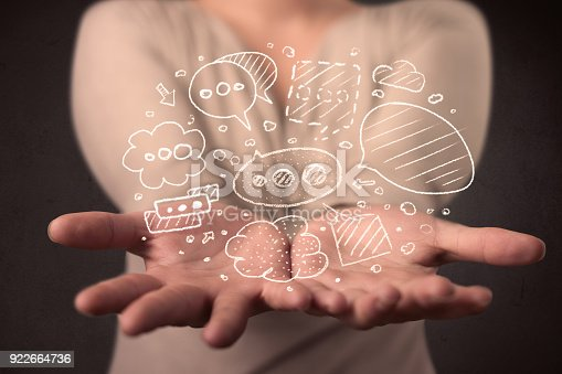 1190039622istockphoto Woman holding speech bubbles 922664736