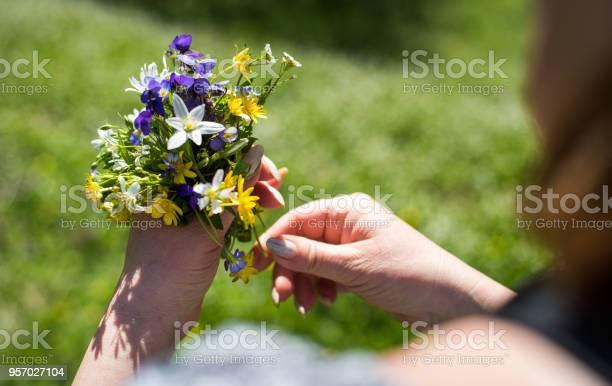 Woman holding spring flowers bouquet picture id957027104?b=1&k=6&m=957027104&s=612x612&h=sedtcd3icbvgy8jb8ljrdidsjsrh rfcdensbie40i8=