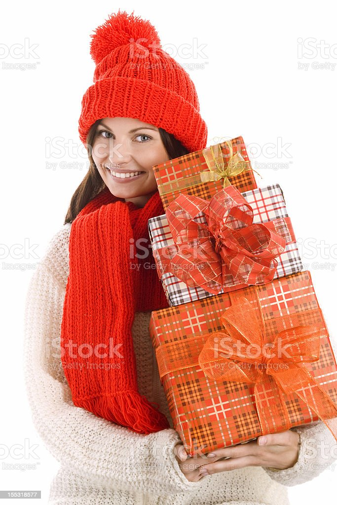 Woman holding stack of gifts royalty-free stock photo