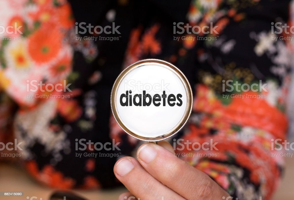 woman holding stethoscope with diabetes text, concept cancer stock photo