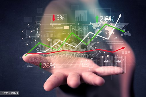 1190039622istockphoto Woman holding stock data 922665074