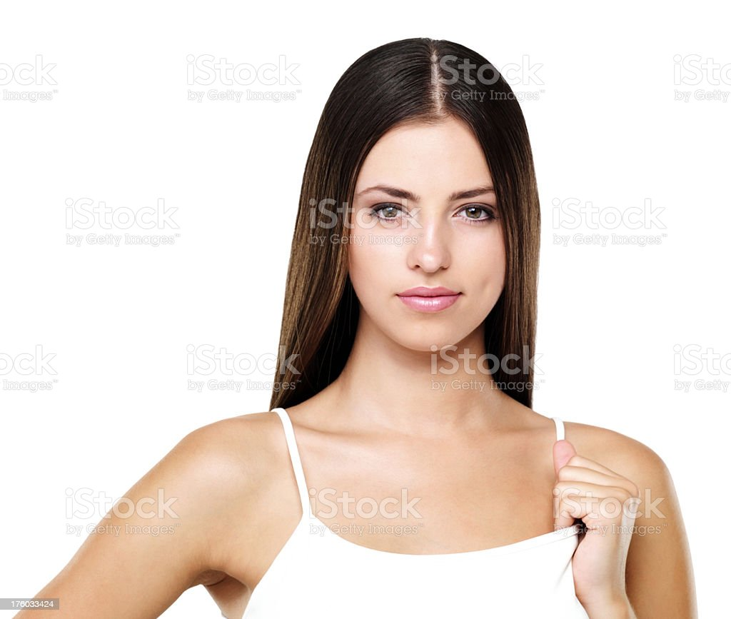 Woman holding strap of her spaghetti top stock photo