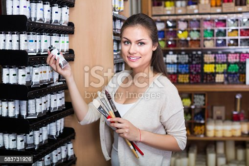 594918592 istock photo Woman holding supplies for painting 583731926