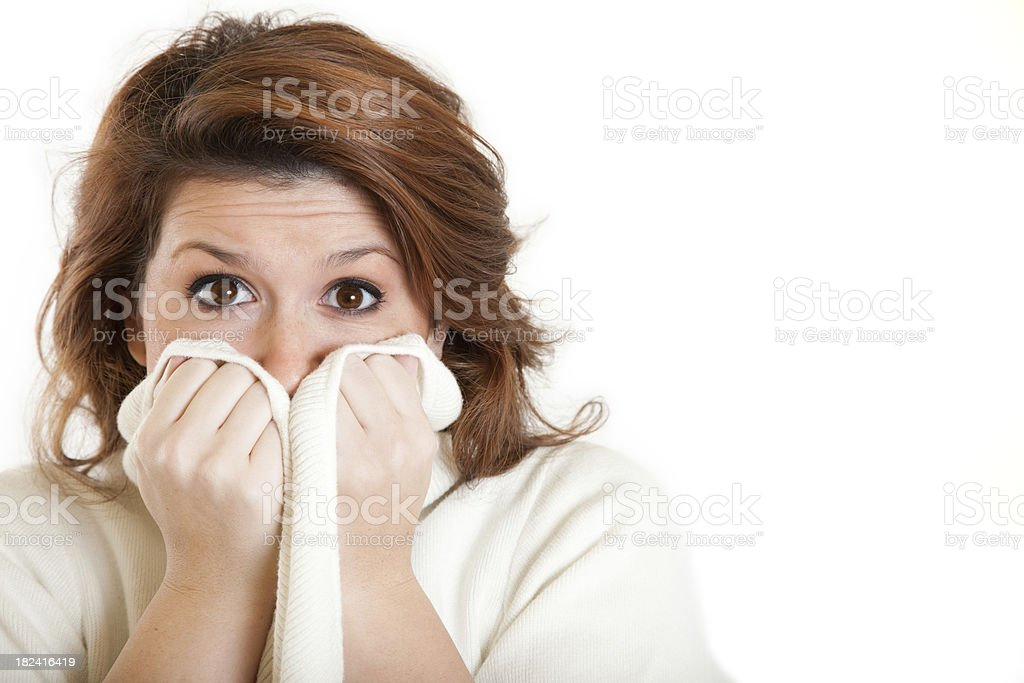 Woman Holding Sweater Up Over Mouth royalty-free stock photo