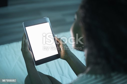 istock Woman Holding Tablet PC At Night Mockup 987956582