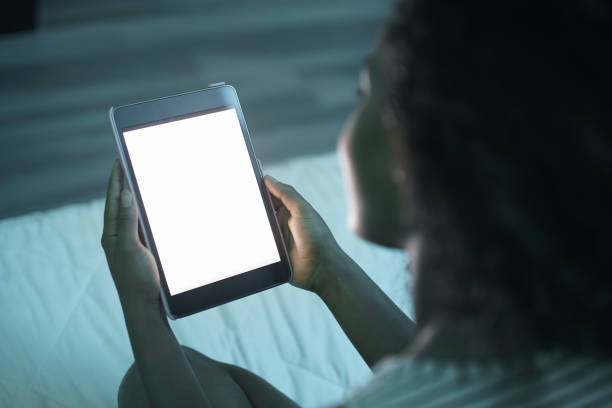 Woman Holding Tablet PC At Night Mockup stock photo