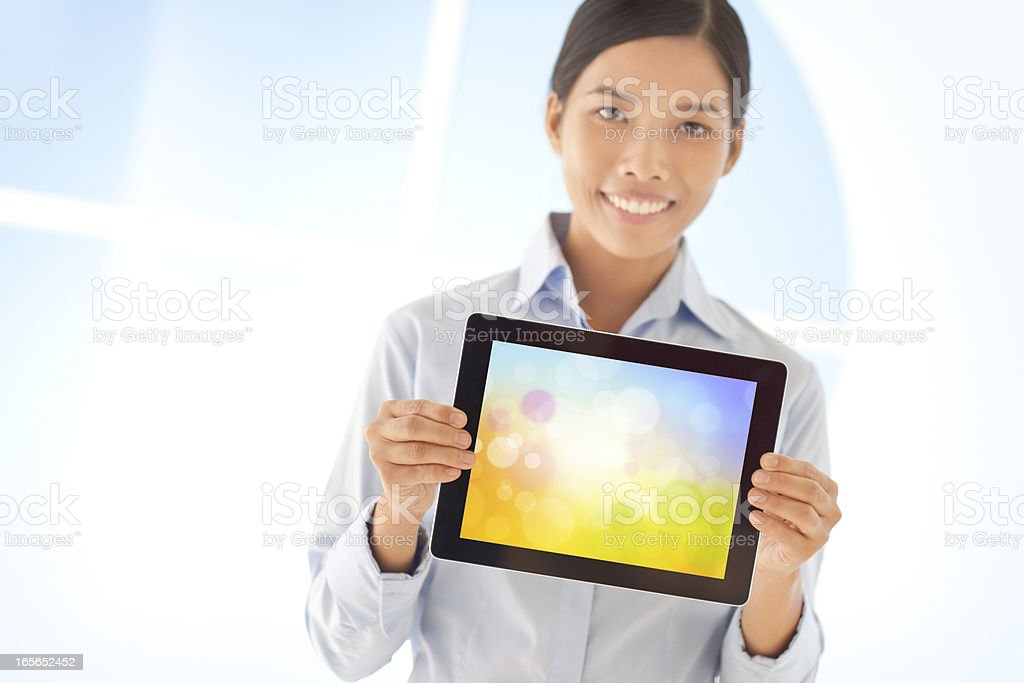 Woman Holding Tablet stock photo