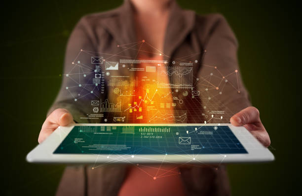 frau holding tablet mit business-plan-grafik - soziologie stock-fotos und bilder