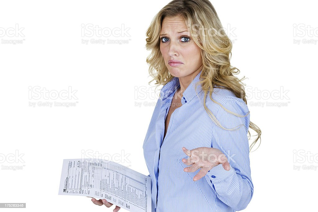 Woman holding tax form and shrugging royalty-free stock photo