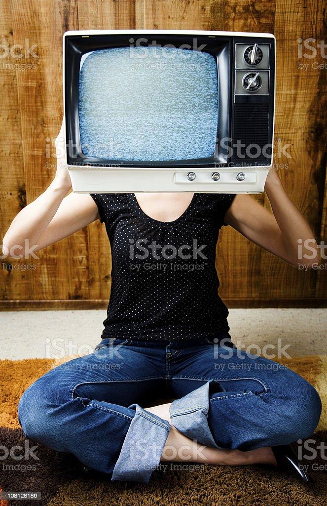 Woman Holding Television Near Head royalty-free stock photo