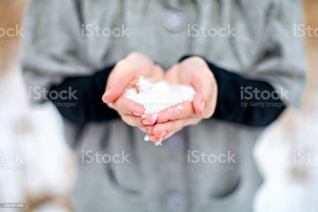 Woman holding the snow stock photo
