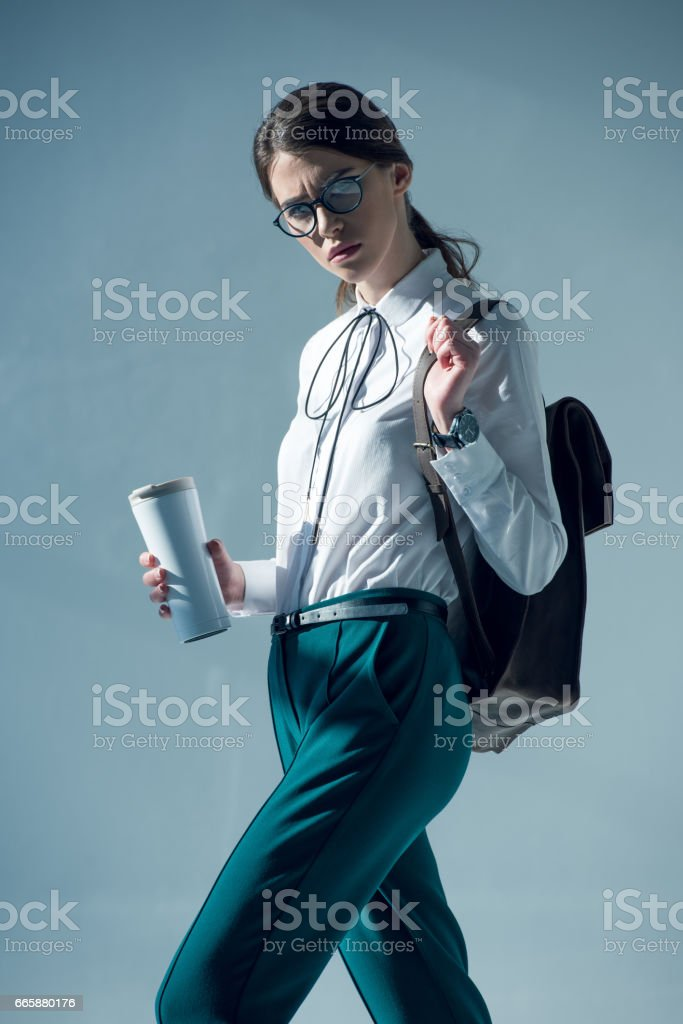 woman holding thermos stock photo