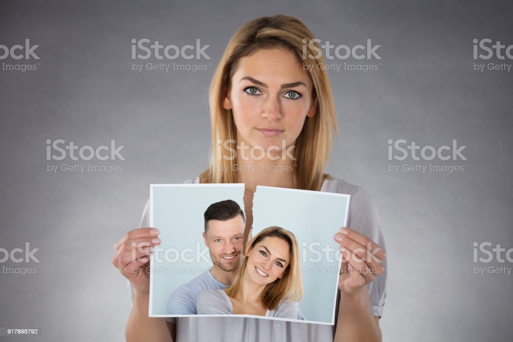 Woman Holding Torn Photo stock photo