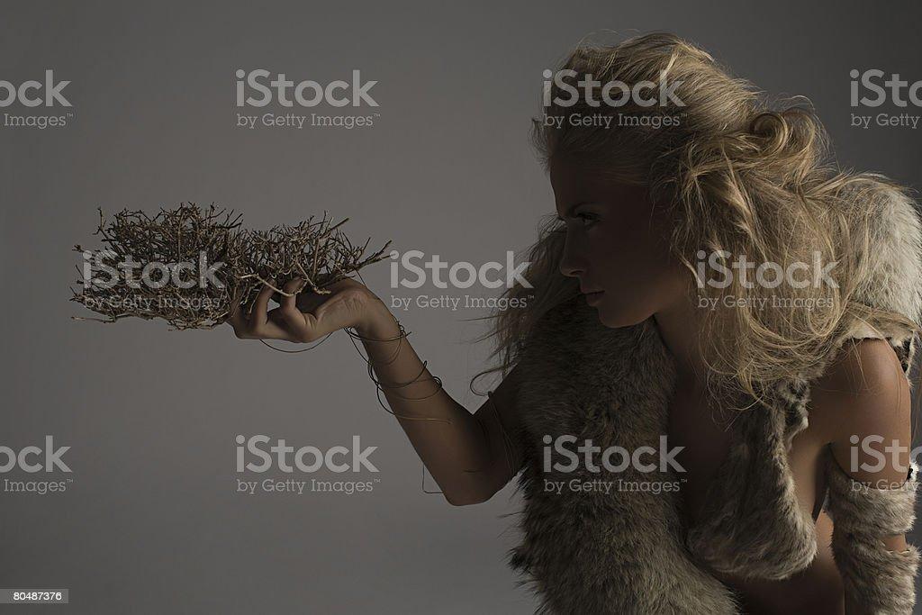 A woman holding twigs 免版稅 stock photo