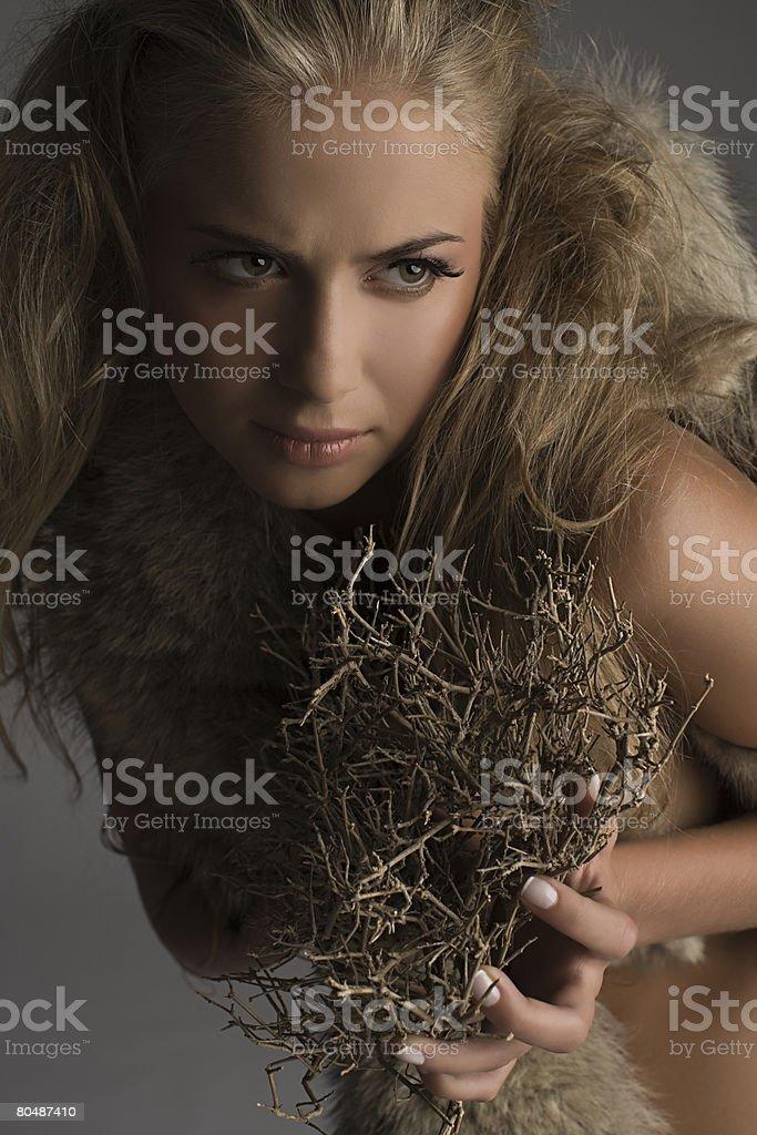 トゥイグスを持つ女性 ロイヤリティフリーストックフォト