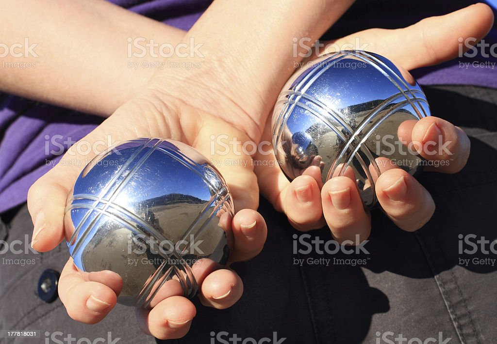 Woman holding two boules stock photo