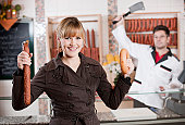 Woman holding two sausages