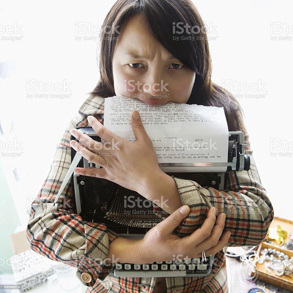 Woman holding typewriter. royalty-free stock photo