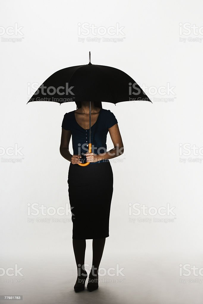 Woman holding umbrella 免版稅 stock photo