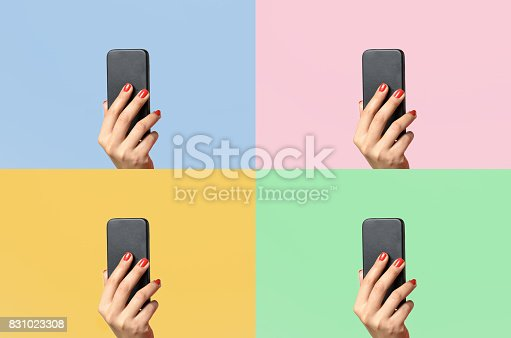 Woman with varnished red fingernails holding up a mobile phone on four different colors of background with copy space