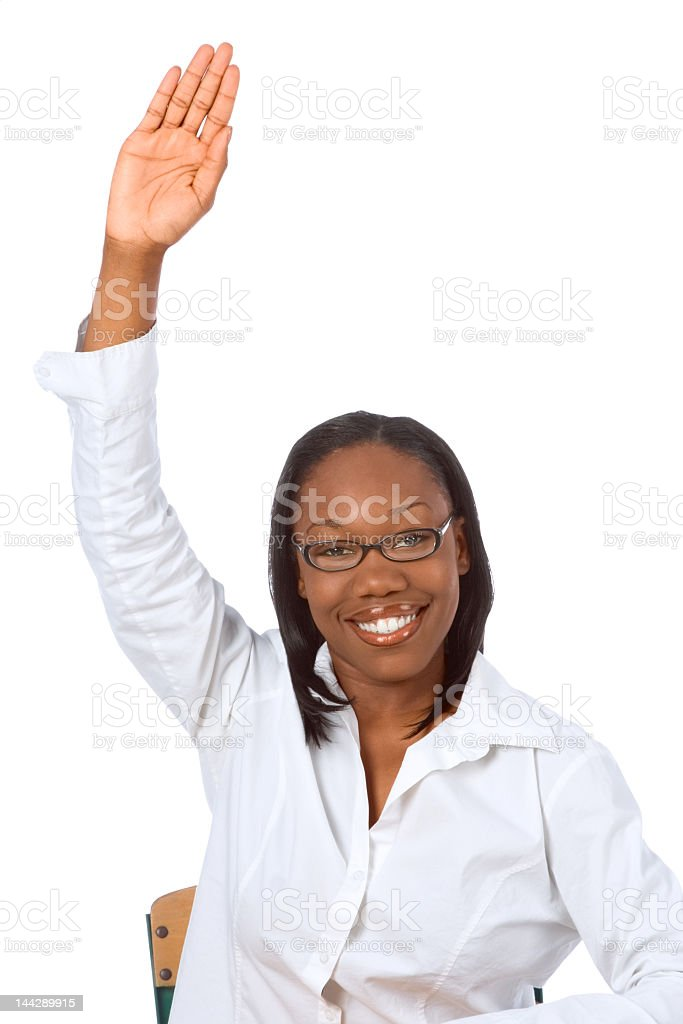 A woman holding up her hand to answer a question royalty-free stock photo