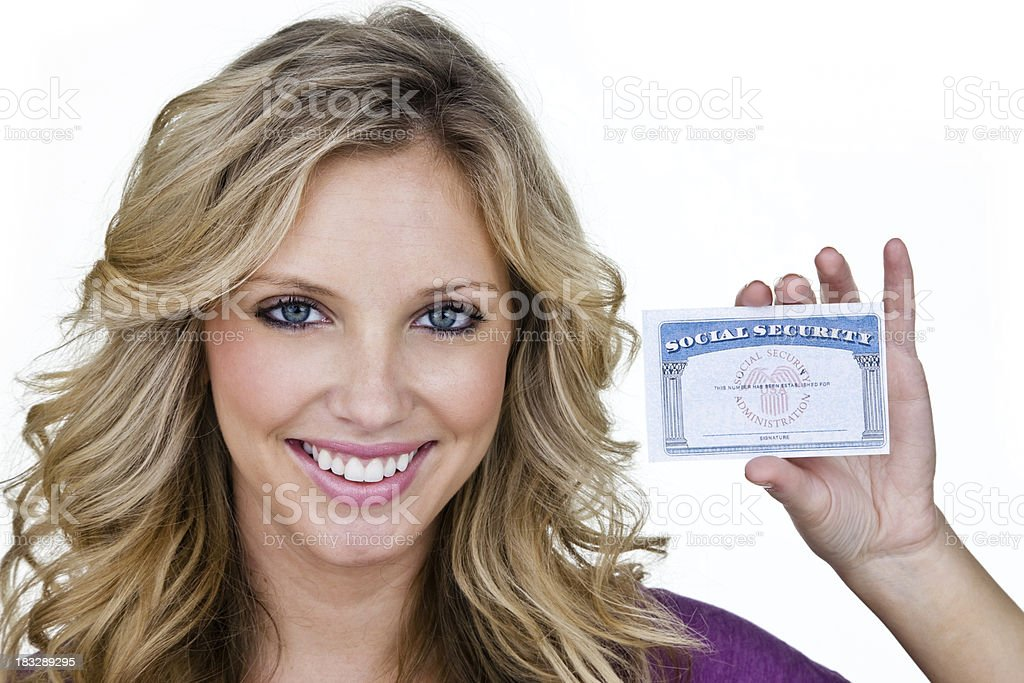 Woman holding up ID stock photo