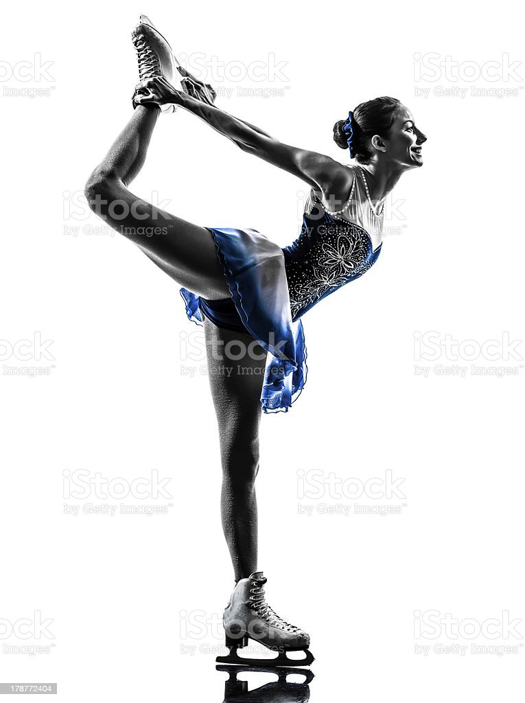 Woman holding up leg in ice skating pose stock photo