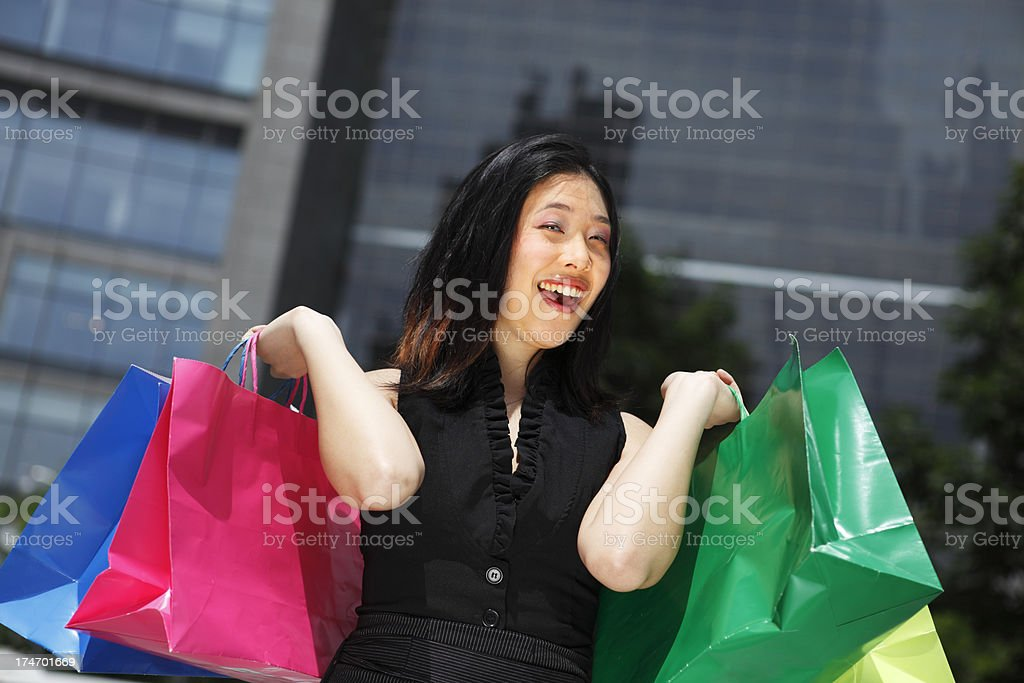 Woman Holding Up Shopping Bags stock photo