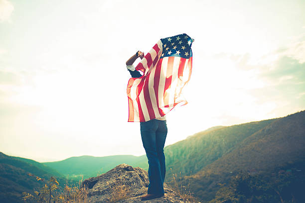 Woman holding US flag stock photo