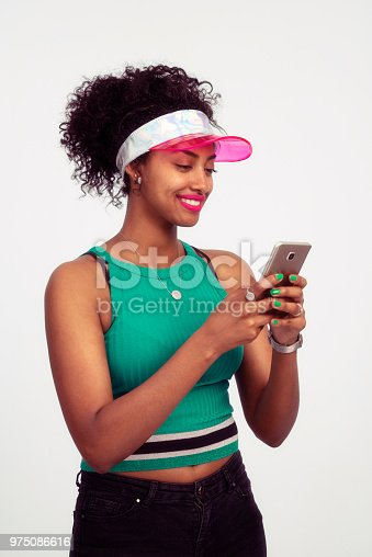 946192604 istock photo Woman holding, using mobile phone, sending SMS / message, online, internet, social network. 975086616