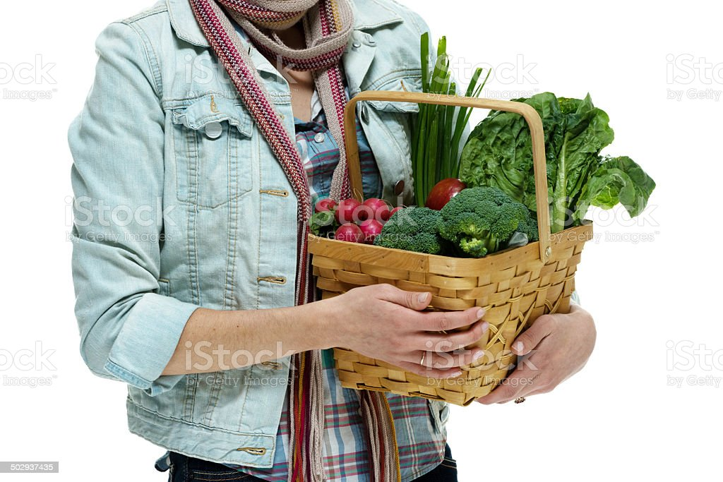 Woman holding vegetable basket royalty-free stock photo