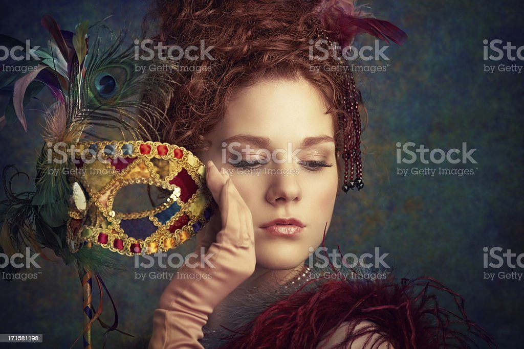 woman holding venetian mask royalty-free stock photo