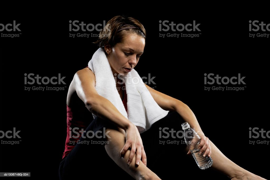 Woman holding water bottle royalty-free stock photo