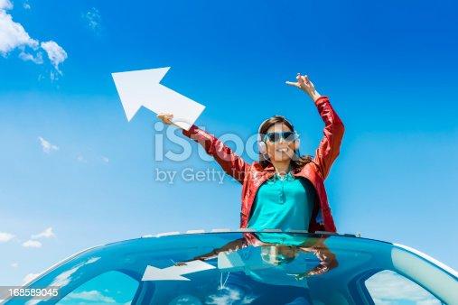 168589045 istock photo Woman holding white arrow 168589045