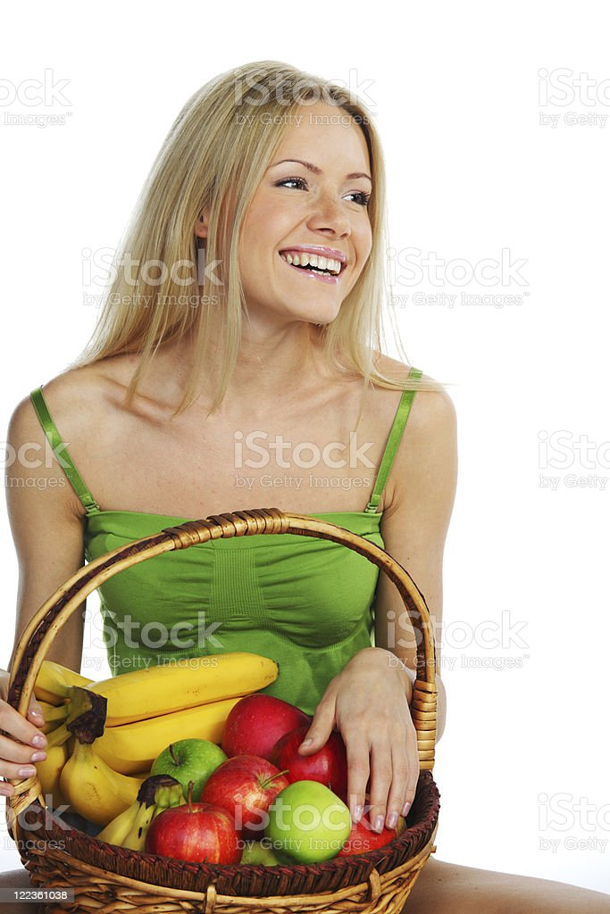 woman holds a basket of fruit royalty-free stock photo