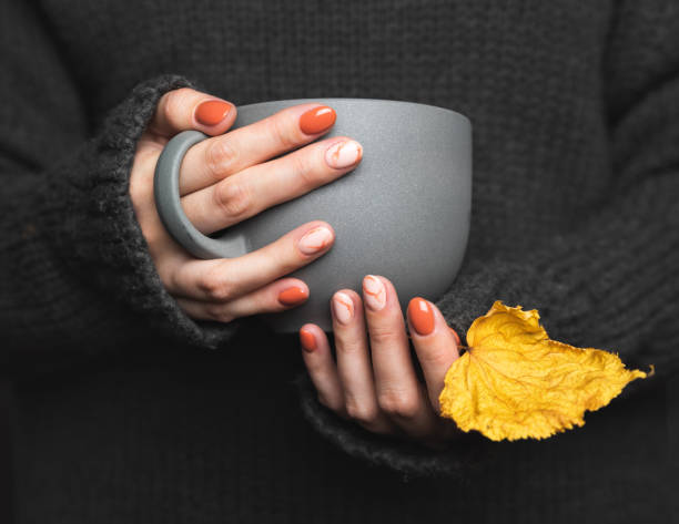 woman holds a cup of hot tea. grey knitted sweater - autumn stock pictures, royalty-free photos & images
