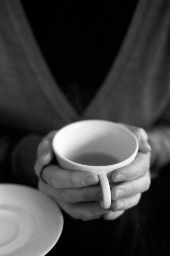 Woman Holds A Warm Cup Of Tea In Her Hands Stock Photo - Download Image Now